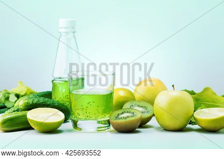 Fresh Green Fruits, Vegetables And Green Smoothie In Glass On The Table. Detox, Diet Or Healthy Food