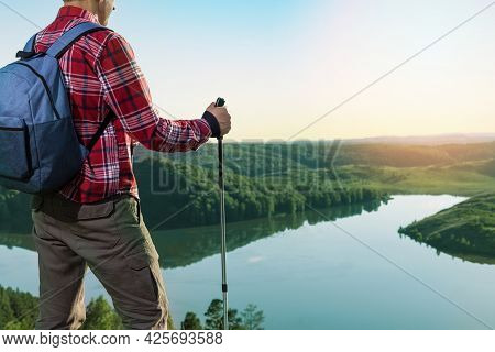 Man In Contemplation, Sunset, Nature. Man Standing On A Top Of Mountain, Enjoying The Beautiful Suns
