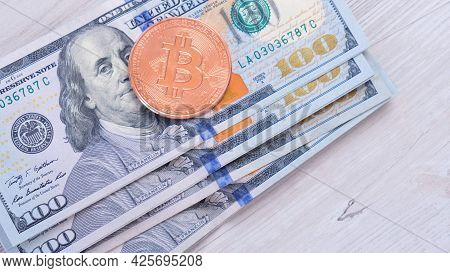 Bitcoin Cryptocurrency Coins On One Hundred Us Dollar. Virtual Cryptocurrency Concept. Bitcoin Btc C