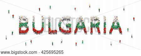 A Crowd Of People Stands In Green, White And Red Robes, Making Up The Word Bulgaria. Bulgaria Flag M