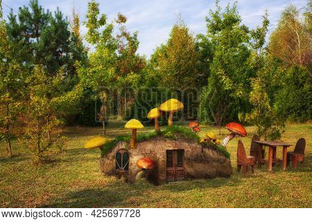 A Fantasy House For Fairy-tale Inhabitants In A Clearing In The Middle Of The Forest, Overgrown With