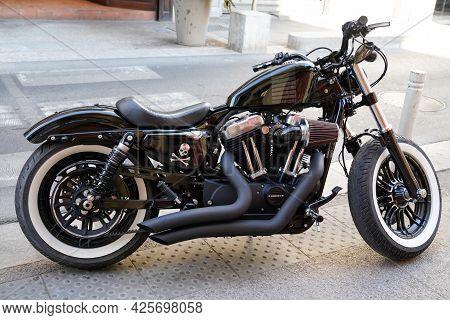 Sète , Ocitanie France  - 06 30 2021 : Harley-davidson 1200 Motorcycle Black Parked In Street Custom