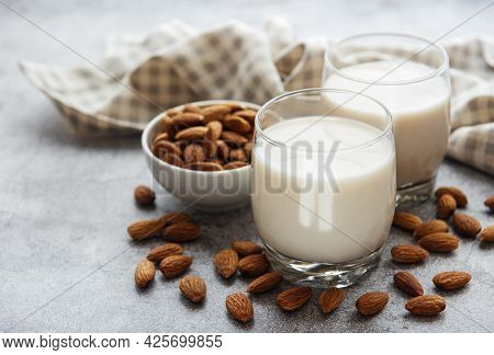 Glasses With Almond Milk And Almonds On The Table
