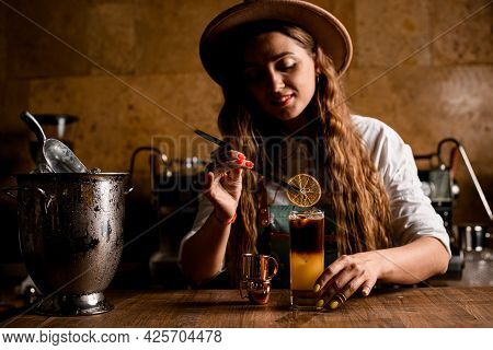 Young Woman Neatly Decorates Glass With Bumble Coffee With Slice Of Orange