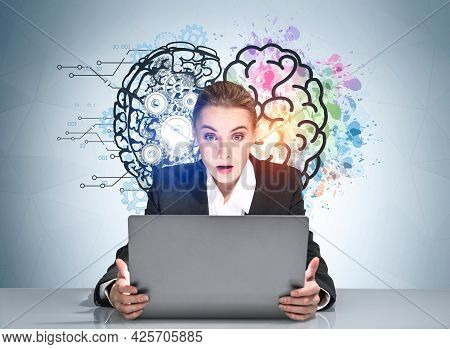 Amazed Businesswoman Is Looking Into Laptop And Impressed By Colorful Brain Sketch With Cog Wheels.