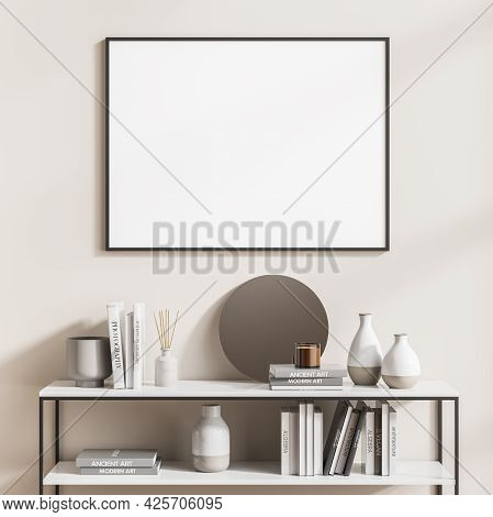 Wide Empty Framed Poster On The Beige Wall With Low Black And White Shelf With Books, Vases, Candle
