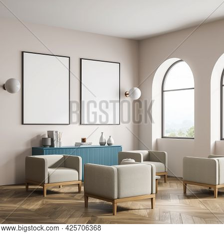 Beige Interior With Blue Sideboard. Two Placards On The Wall Above And Two Spherical White Lamps. Tw