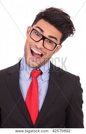 closeup portrait of a young business man acting crazy, tilting his head and opening his mouth while looking at the camera on a white background