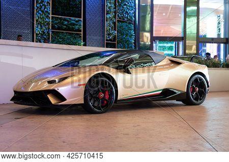 Palm Beach, Florida Usa - March 22, 2021: Gold Lamborghini Aventador Luxury Sport Car. Side View.