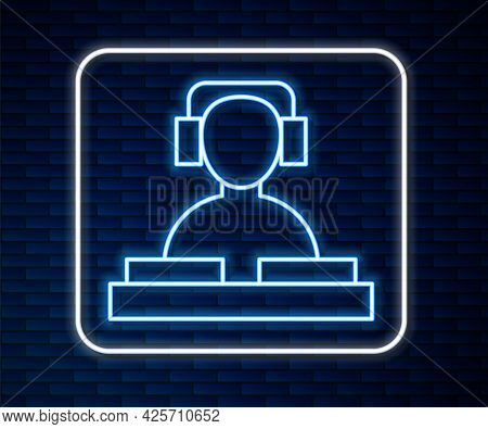 Glowing Neon Line Dj Wearing Headphones In Front Of Record Decks Icon Isolated On Brick Wall Backgro