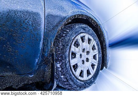Car Tire In Winter On An Icy Road - Winter Tire - Abstract Isolated Photo Of Frozen Winter Car Tires