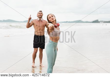 Cheerful Male And Female Athlete Standing Together At Seaside. Healthy Men And Women Pose For Sexy P