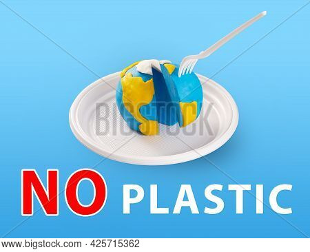 Worldearth Day Concept. Plastic Free Concept. Pollution Problem Concept. A Plastic Plug Stuck Into T