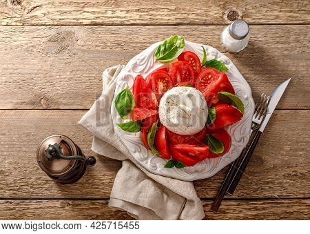 Burrata Salad On White Vintage Plate. Top View Of Salad With Burrata Cheese And Basil Leaves.