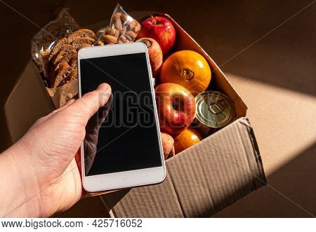 Healthy Food Delivery Smartphone Touchscreen Mockup In Hand Template Banner. Take Away Product Packa