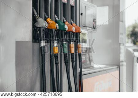 Detail Of A Petrol Pump In A Petrol Station. Various Refueling Guns.
