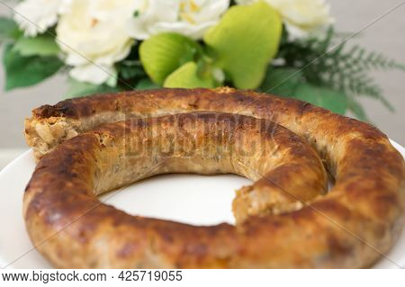 Fried Sausage Rolled Up In A Spiral Ready To Eat