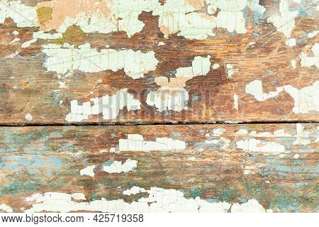 The Background Of The Texture Of The Surface Of The Old Board Covered With Paint And Weathered For D