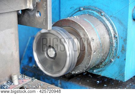 Metalworking Process On A Lathe. Frazing Of Metal Structures. Industry.