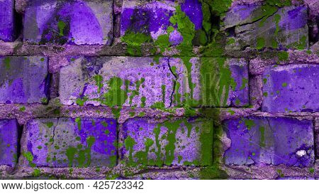 Purple Brick Wall In A Splash Of Paint. Creative Wall Background. Texture Brick Wall Copy Space.