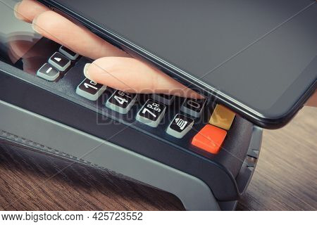 Mobile Phone Or Smartphone With Payment Terminal. Credit Card Reader. Cashless Paying For Shopping.