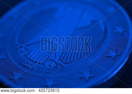 1 Euro Coin Issued In Germany Close-up. Obverse With The Federal Eagle. Dark Blue Tinted Economic Ba