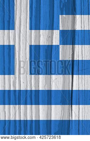 Fragment Of Flag Of Greece On Dry Wooden Surface, Cracked With Age. Vertical Background Or Wallpaper
