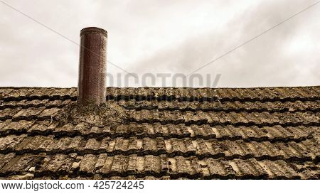 Chimney On The Roof Of An Old House. Slate Roof.