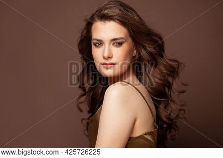Portrait Of Pretty Woman With Dark Hair, Blue Eyes, Natural Skin. Beautiful Model Smiling