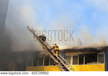 Blurred Photo, Two Firefighters Rescuers Climb The Stairs To The Fire