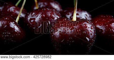 Cherry Berries With Drops Of Water On The Peel. Cherry Background.