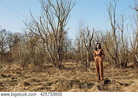 Beautiful Young Girl In Brown Trousers And A Leather Shirt On  Sunny Day