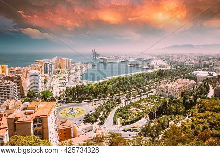 Malaga, Spain. Cityscape Elevated View Of Malaga In Sunny Summer Evening. Altered Sunset Sky.