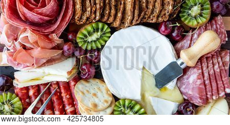 Top Down View Of Various Meats And Cheeses, Ready For Snacking.