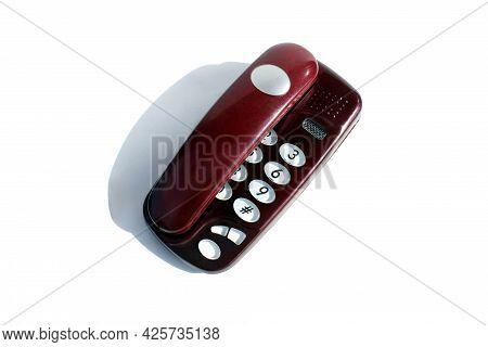 Burgundy Landline Phone Stands On A White Background