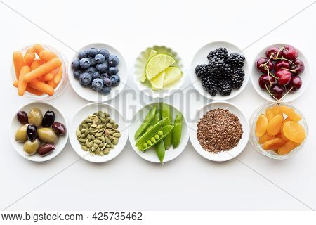 Rows Of Raw Healthy Ingredients In Small Dishes.