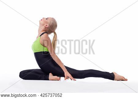 Yoga In Progress. Horizontal Profile Shot Of An Attractive Female Performing Yoga Asana Isolated On