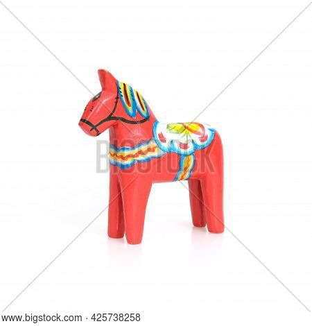 Red Dalarn Horse: Gift Figurine From Sweden Isolated On White Background