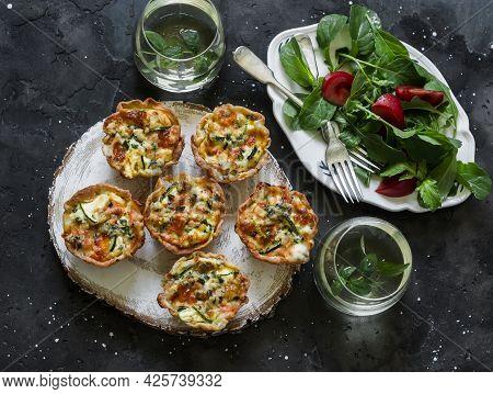 Aperitif Table - Mini Quiche With Salmon And Zucchini, Fresh Tomato Arugula Salad And Mint Cocktail