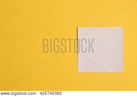 Memo Note Isolated On Yellow Background. Copy Space For The Text.