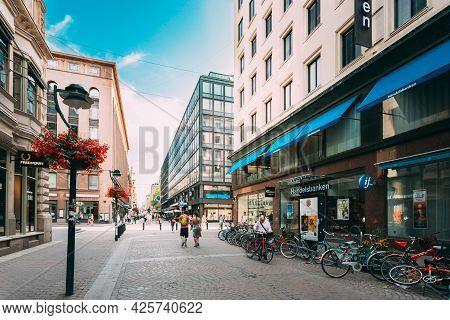 Helsinki, Finland - July 28, 2014: View Of Kluuvikatu Street. Parked Bicycles On Sidewalk.