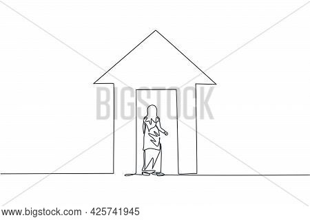 Single One Line Drawing Of Young Arabian Businesswoman Enter The Up Arrow Building. Business Financi