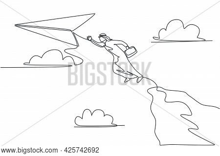 Single One Line Drawing Young Arabian Business Man Jumping High From Top Cliff To Reach Flying Paper