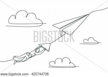 Single Continuous Line Drawing Of Young Business Man Hanging On Flying Big Paper Airplane. Business