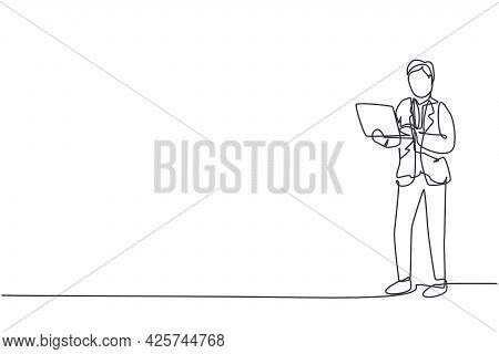 Single One Line Drawing Of Young Smart Business Man With Suit Standing While Holding A Laptop. Busin