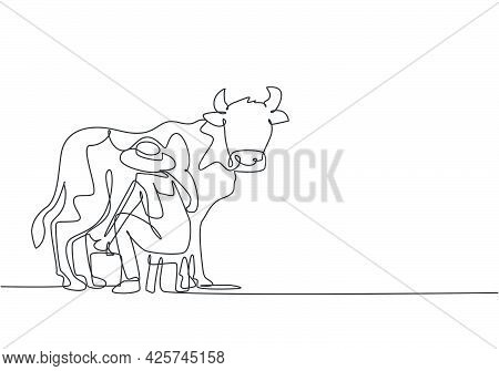 Single Continuous Line Drawing Young Male Farmer Milking A Cow With Traditional Way. A Successful Ha