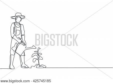 Single Continuous Line Drawing Young Male Farmer Water The Plants Using A Watering Can. Farmer Plant