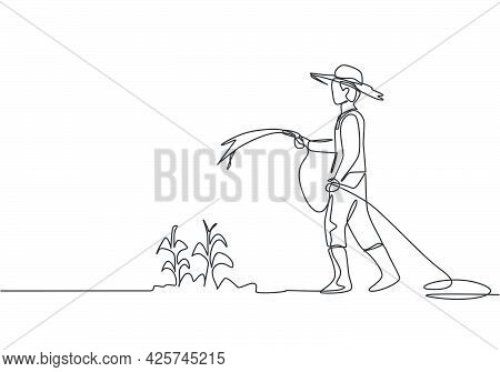 Single Continuous Line Drawing Young Male Farmer Standing On Farm Field While Watering The Plants Us