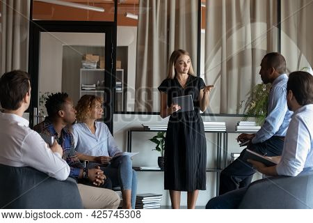 Confident Businesswoman Mentor Leading Corporate Meeting Briefing With Diverse Employees