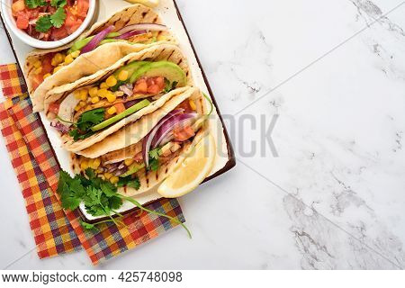 Mexican Tacos With Grilled Chicken, Avocado, Corn Kernels, Tomato, Onion, Cilantro And Salsa At Whit
